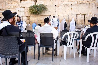 Jewish Orthodox men studying Torah