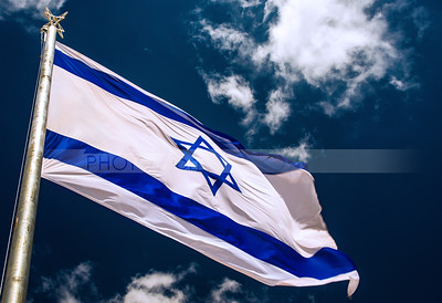 Israeli flag with cloudy sky