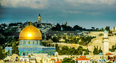 Sun light hitting the golden Dome of the Rock and the Church of Ascension on the Mount of Olives