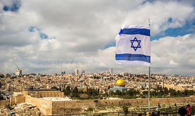 Israeli flag flying over Jerusalem