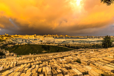 Jewish cemetery on the Mount of Olives, with dramatic sky over Jerusalem