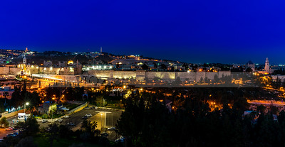 Night view of Jerusalem Old City Walls with the Mount of Olives in the background