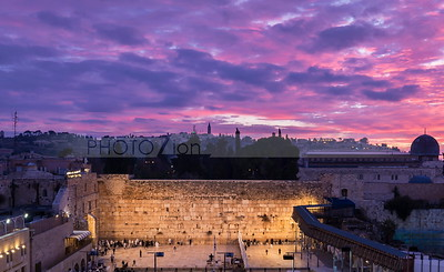 Western Wall with beautiful sunrise clouds