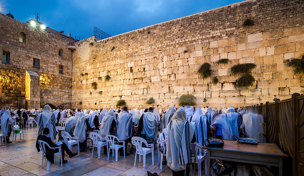 Jewish people at morning prayers at the Western Wall