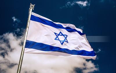 Israeli flag with cloudy sky