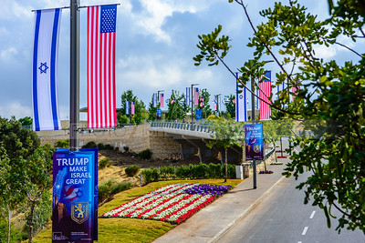 Road towards a new US embassy in Jerusalem, adorned with American and Israeli flags