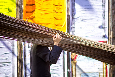 Jewish Orthodox man carrying  branches for schach sukkah covering - Sukkot preparations in Mea Shearim