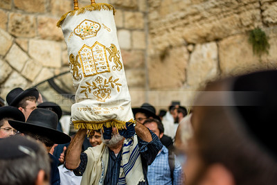 Holding up Torah Scroll