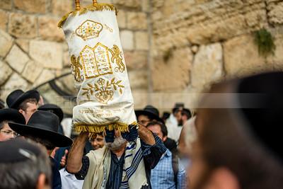 Holding up Torah Scroll