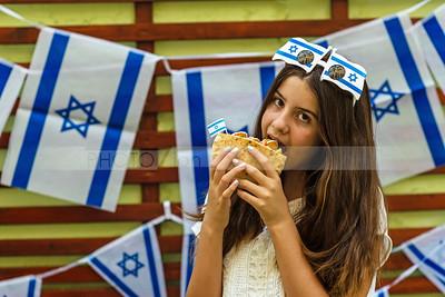 Israeli girl holding pita with falafel; Independence Day