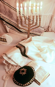 Jewish religious objects: Menorah, kippah (yarmulke), siddur prayer book, tallit and tzitzit