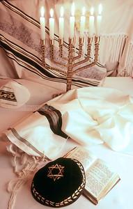Jewish religious objects: Menorah, kippah (yarmulke), siddur prayer book, tallit and tzitzit