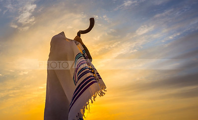 Blowing the Shofar - man in a tallith, Jewish prayer shawl is blowing the shofar ram's horn