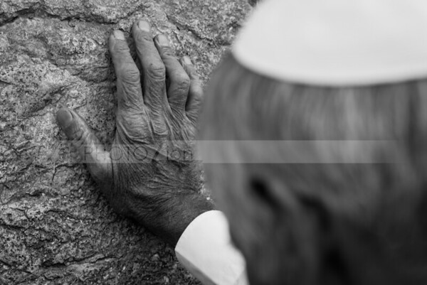 Hand touching Western Wall