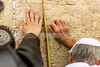 Hands touching Western Wall