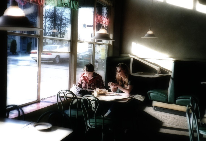 Two friends in Seattle coffee shop.
