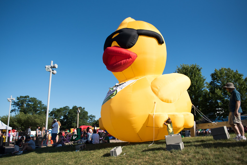 . A giant blow up duck sits on display during Sunday\'s duck race at Riverfront Park in Fitchburg on July 9, 2017.  SENTINEL & ENTERPRISE JEFF PORTER