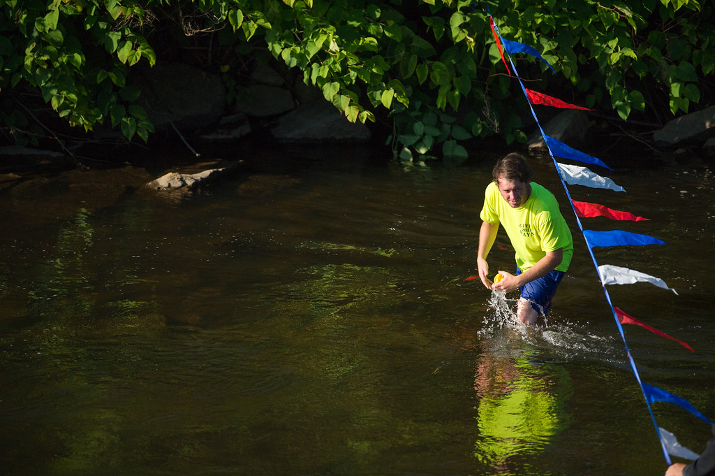 . Fitchburg rec director Nate LaRoe grabs the last duck to cross the finish during Sunday\'s duck race at Riverfront Park in Fitchburg on July 9, 2017.  SENTINEL & ENTERPRISE JEFF PORTER