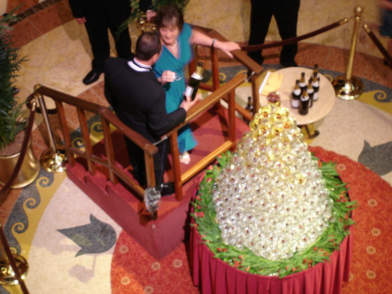 Maitre D' helps someone pour champagne onto the waterfall