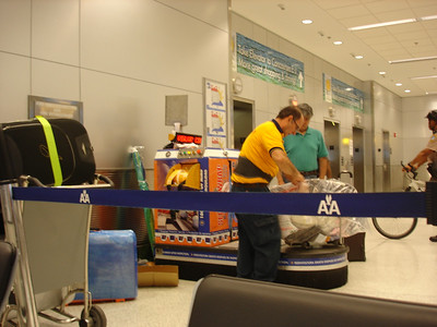 Watching them wrap luggage in plastic wrap for a fee