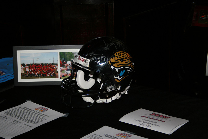 A Jaguar helmet from the 1/2 and 1/2 game was one of the many items in the silent auction.