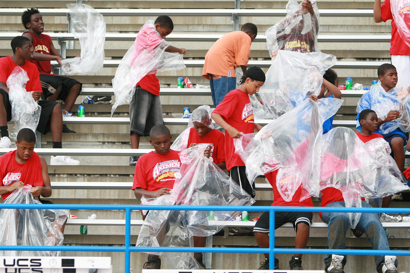 Kids from rugby camp break out ponchos as the rain threatens.