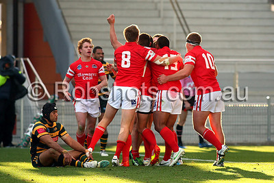 Illawarra Cutters celebrate a late try - Images from the Round 26 match between the Illawarra Cutters and the Windsor Wolves played at WIN Stadium in Wollongong on Saturday the 1st of September 2012. The match was won by Illawarra 18-9 (Photo: Rob Sheeley)