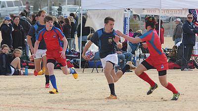 2014_01-24 Rugby LV Sevens NorCal AllStars Chris (Jesuit) w ball evading a tackle_1995