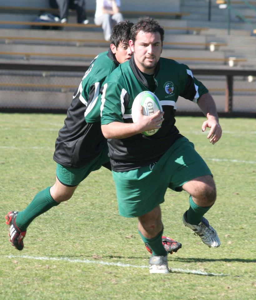 Derek Thompson (Peninsula Green Rugby Alumni) taking the ball up field against the Stanford U19 team on Feb 9, 2008.