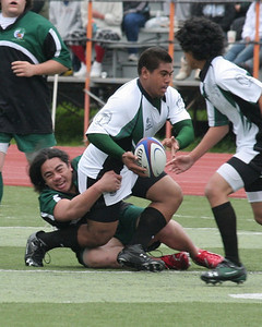 Lolo Mahafutau of Peninsula Green Rugby tackles Patrick Latu (former PGRFC team mate) against San Mateo on Feb 23, 2008