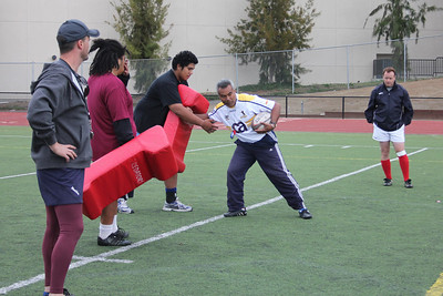 Coach Moses Similai demonstrates how to step into a tackle and protect the ball during the rucking drill on Sat 11-02-11.