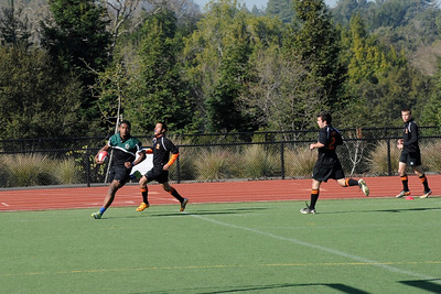 2012 Peninsula Green Rugby vs Los Gatos Lions 01-14-12: Mark Qoro leaves a number of Los Gatos defenders in his wake during one of his many run and turns into the center to score the try between the posts. (023)