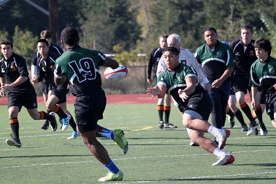 2012 Peninsula Green Rugby vs Los Gatos Lions 01-14-12: George Fifita passes to Mark Qorowho takes the rugby ball in stride to move it up the field as Erik Cortinus and Sam Vaimau move in support.. (3269)