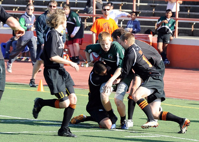2012 Peninsula Green Rugby vs Los Gatos Lions 01-14-12: Andrew Bowler runs up field through multiple Los Gatos defenders as part of a nice back line movement. (021)