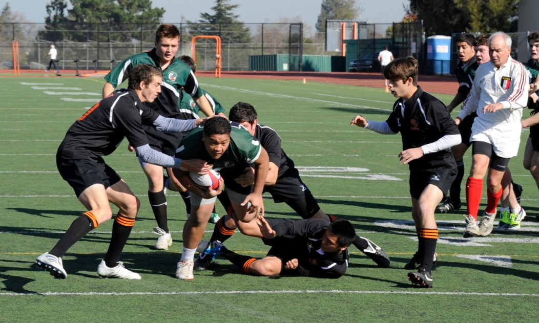 2012 Peninsula Green Rugby vs Los Gatos Lions 01-14-12: George Fifita runs up field through multiple Los Gatos defenders on his way to a try.  John (Rambo) Warnock is in support. (004)