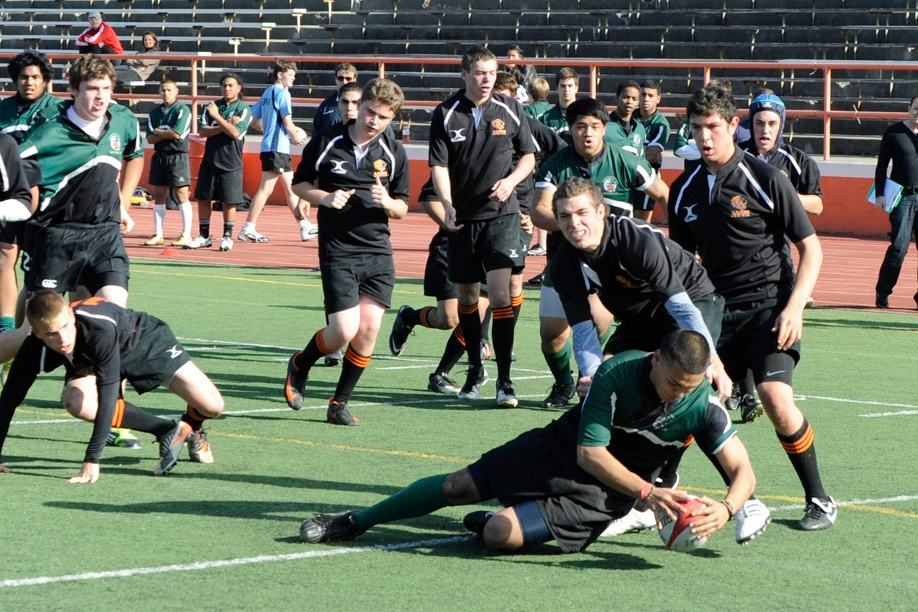 2012 Peninsula Green Rugby vs Los Gatos Lions 01-14-12: Alex Avendano places the ball down to score a try after running through Los Gatos defender. Clsup (084)