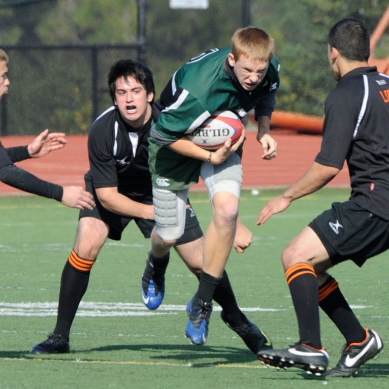 2012 Peninsula Green Rugby vs Los Gatos Lions 01-14-12: Andrew Bowles hurtles himself through Los Gatos opposition with a look of determination that alone will ensure that he is successful (016)