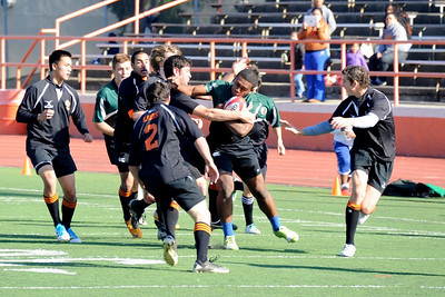 2012 Peninsula Green Rugby vs Los Gatos Lions 01-14-12: Mark Qoro fights through a number of Los Gatos defenders on his way up field with John Warnock in support.. (015)