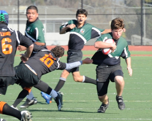 2012 Peninsula Green Rugby vs Los Gatos Lions 01-14-12: Ryan Foster runs with determination on one of his many North-South expeditions through Los Gatos traffic with Alex Everett and Sam Vaimau in close support (016)