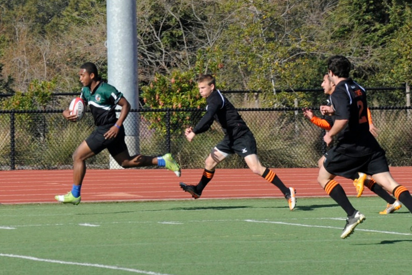 2012 Peninsula Green Rugby vs Los Gatos Lions 01-14-12: Mark Qoro leaves a number of Los Gatos defenders in his wake during one of his many runs.  This one results in a try. (Clsup). (022)
