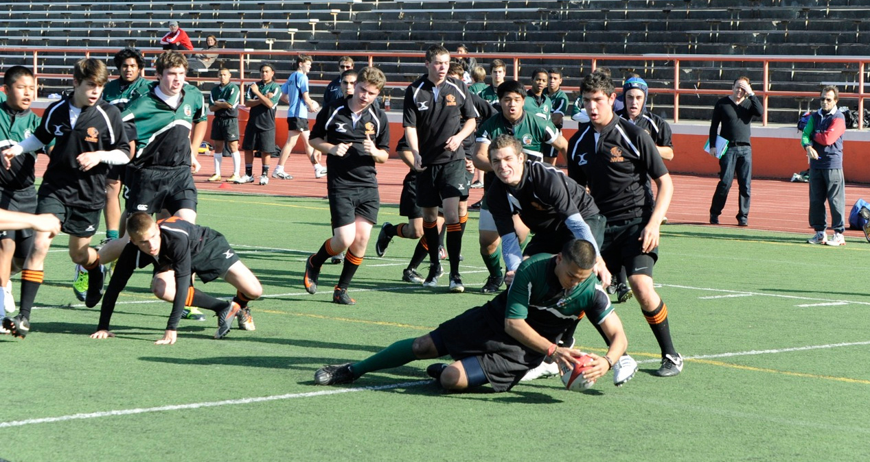 2012 Peninsula Green Rugby vs Los Gatos Lions 01-14-12: Alex Avendano places the ball down to score a try after running through Los Gatos defenders. (084)