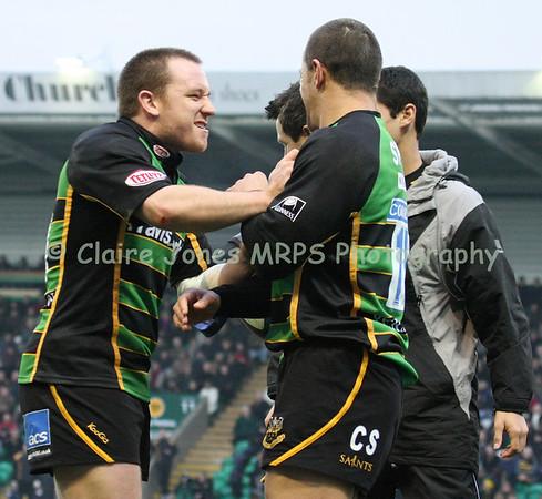 Paul Diggin congratulates Carlos Spencer