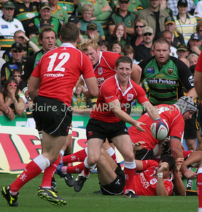 Greg Nicholls clears the ruck to Greg Evans