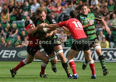 Karl Rudzki tackled by Greg Evans and Gareth Morgan