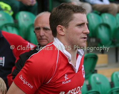 Greg Nicholls leads his London Welsh team on to the pitch