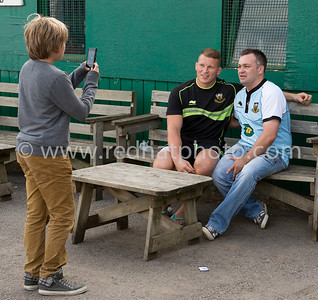 Dad looks anxiously on as his son takes a photo of him with Dylan Hartley