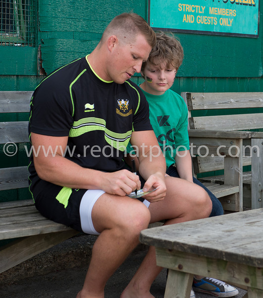 Dylan Hartley signs a young supporter's ticket