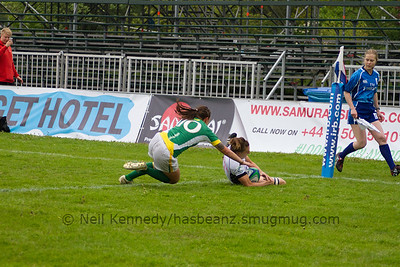 Christy Ringgenberg crosses the line to score a try with Maira Behrendt in pursuit