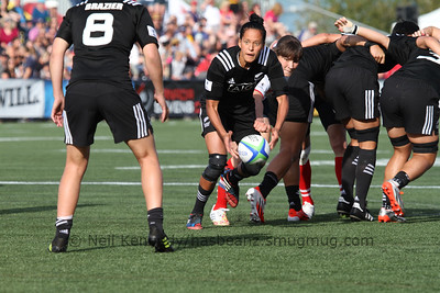 Nadezhda Kudinova reaches for theball at the scrum as Tyla Nathan-Wong passes to Kelly Brazier