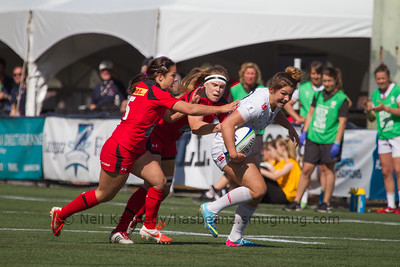 Amy Wilson-Hardy is tackled by Karen Paquin and Ashley Steacy